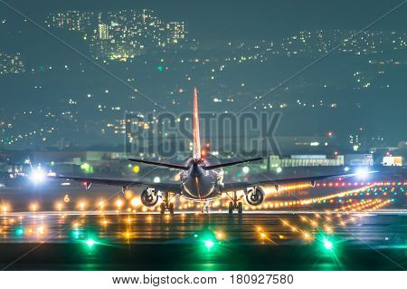 Airplane taking off from the airport in the night.