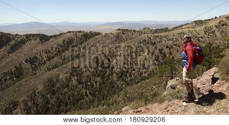 A Bearded Man Hiking in the Mountains Takes in the View Mexico on the Horizon