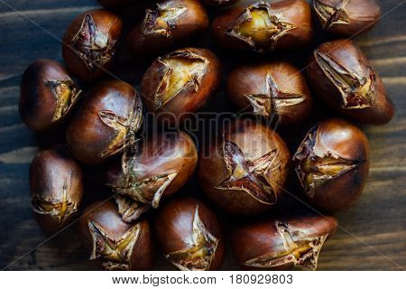 Roasted Chestnuts On Wooden Table
