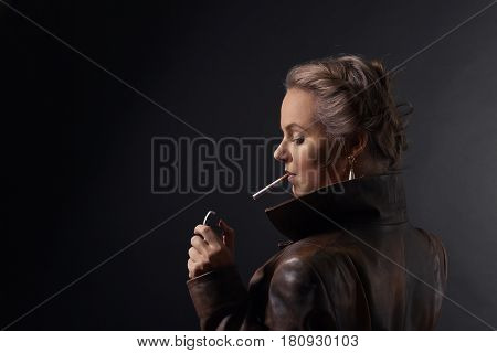 Portrait Of Young Beautiful Woman In Brown Leather Coat