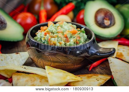 Guacamole With Corn Chips - Nachos, Made From Avocado, Tomatoes And Lime.