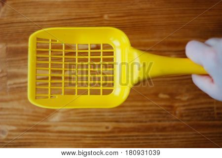 Yellow Plastic Scoop Over The Wooden Background.