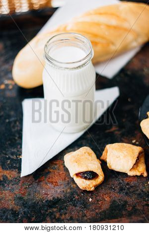 Nice Breakfast - Milk With Croissants On Black Rustic Surface.