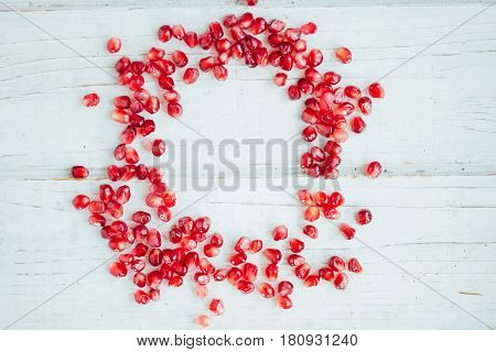 Frame Of Pomegranate Seeds Over White Background.