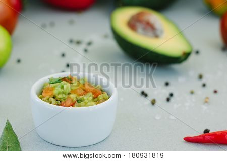 Traditional Mexican Avocado - Vegetarian Dip Surrounded By Its Ingredients.