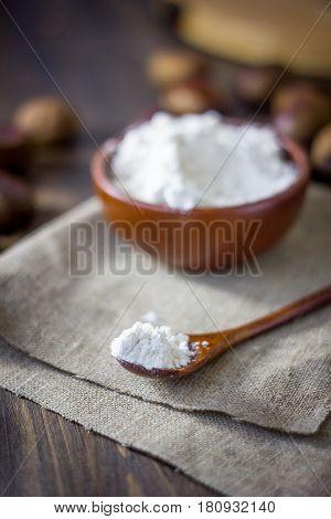 Natural Organic Chestnut Flour In Brown Ceramic Bowl.