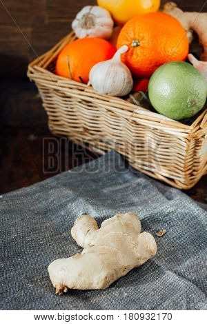 Ginger Root Behind The Basket With Fruits And Vegetables.