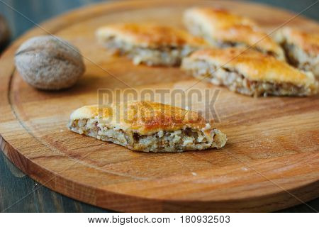 Baklava On Wooden Board Over Rustic Table.