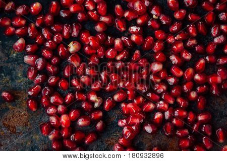 Top view of fresh red pomegranate seeds.