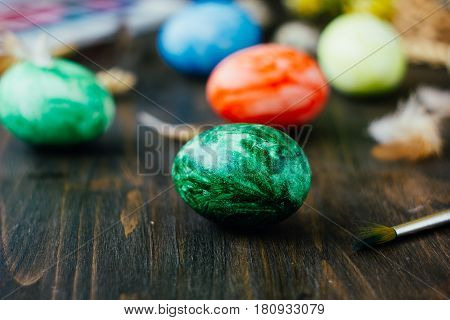 Green Easter Egg Over Brown Rustic Table.