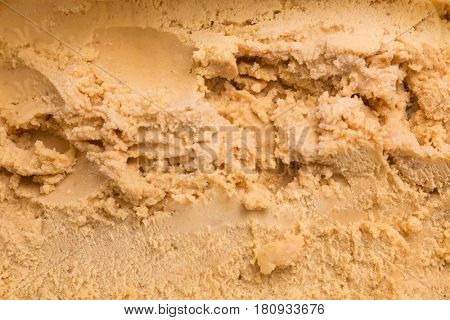 Top view of fresh caramel ice cream as texture for background
