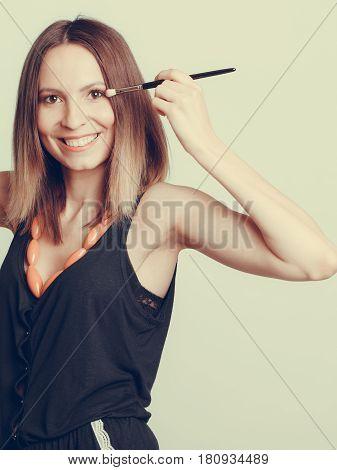 Woman Stylist Applying Eyeshadow With Brush.