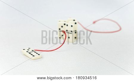 Leadership concept. One domino figure represent major person lead further items in red tow but did not having success.