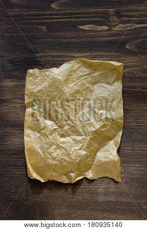 List Of Parchment Paper On Brown Wooden Board.
