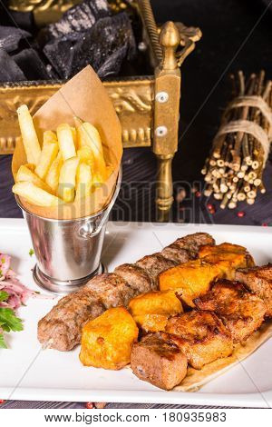 Chicken, the mutton and veal fried on coals is served with ajika and French fries