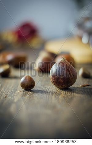 Big Chestnut And Small One On Wooden Table. Raw And Organic Vegan Chestnuts. Variety Of Size.