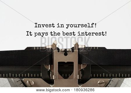 Invest in yourself it pays the best interest text typed on retro typewriter