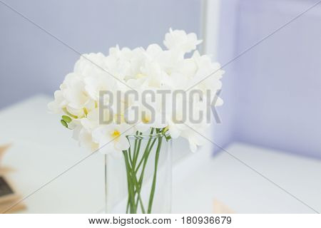 Bouquet Of White Flowers In A Vase Placed On A Table. Cozy Picture. Bouquet Of White Flowers In A Va