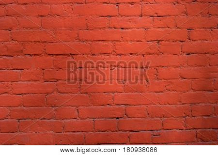 Red brick wall pattern background. The cement between the bricks - Red.