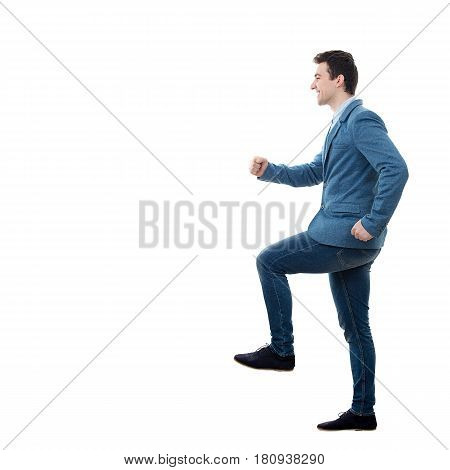 Confident casual man smiling and stepping on staircase to success full length portrait isolated.Self-confidence.