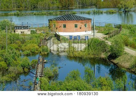 Tyumen, Russia - May 16, 2016: Metelevsky water intake station on Tura river. Water undergoes cleaning and comes to a city water supply system