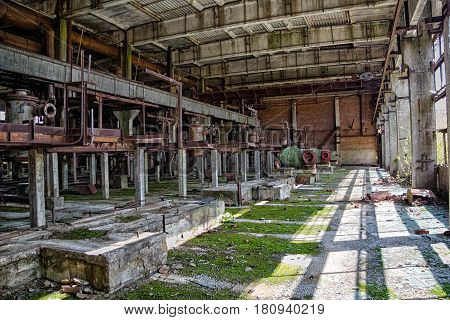 Interior of machinery of abandoned factory of synthetic rubber