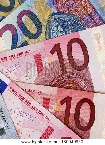 Mixed denomination Euro banknotes with upright crop