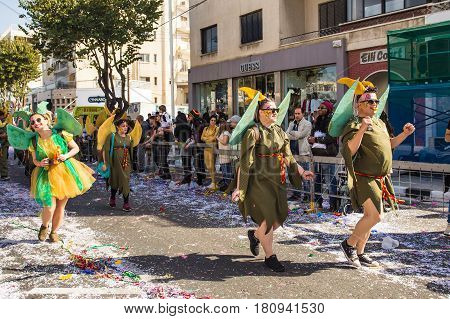 LIMASSOL, CYPRUS - FEBRUARY 26: Grand Carnival Parade - an unidentified people of all ages , gender and nationality in colorful costumes during the street carnival, February 26, 2017 in Limassol, Cyprus.