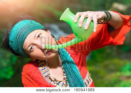 Jala Neti Nasal Irrigation With A Woman In Nature