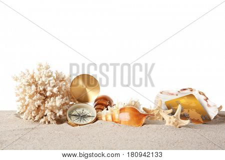 Sand with credit card and coral on white background