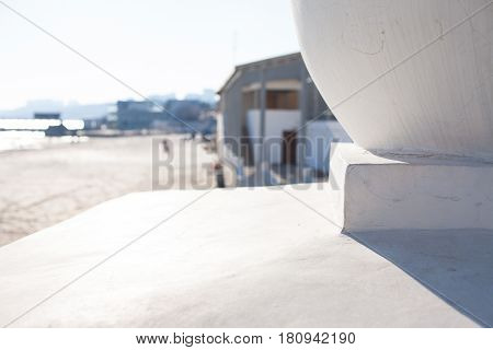Architectural background with Concrete sphere on a parapet in park