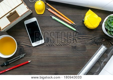 architect office with tools, cup and mobile in profession concept on wooden desk background top view mockup