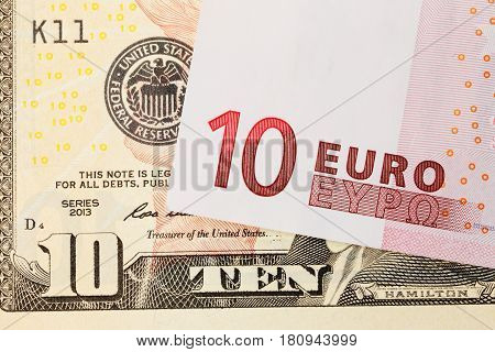 One ten Euro bill on a ten dollars banknote.