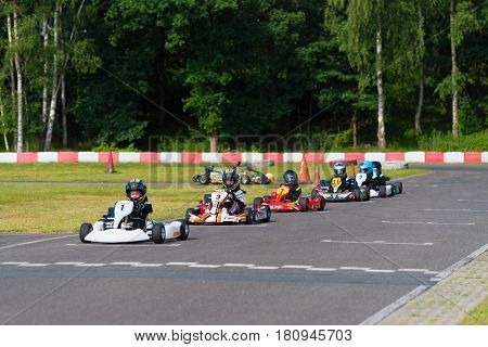 OLDENZAAL NETHERLANDS - JUNE 7 2016: Kids in karts waiting for the launch