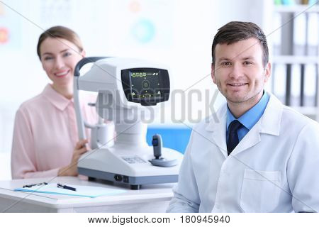 Male doctor examining adult female patient