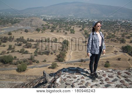 Teotihuacan, Mexico, circa february 2017: View from the pyramid of the sun with an asian girl in Archeological site Teotihuacan, Mexico