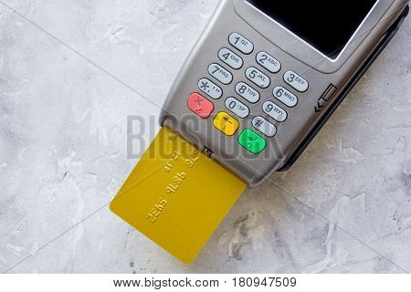 purchasing concept with credit card payment and terminal on stone table background top veiw