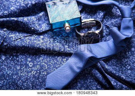 Accessories for men: tie, watch, parfume. Business concept