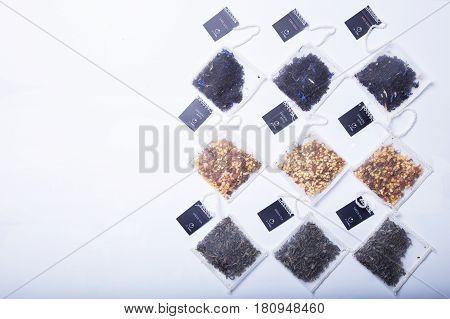Tea bags on a white background. Black, green and fruit tea. Space for text