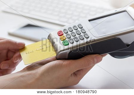 Online payment concept with credit card and terminal for business lunch on white table background
