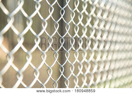 Close up Chain Fence. Metal mesh .  White tone