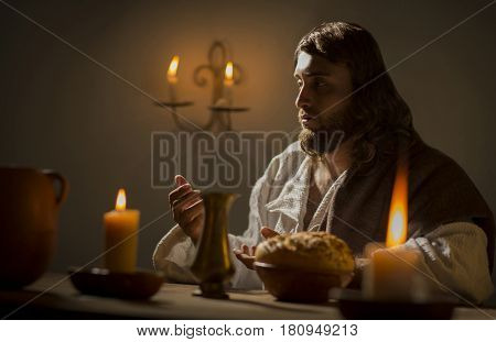 Scene of Jesus Christ blessing the bread and wine during the last supper with his apostles