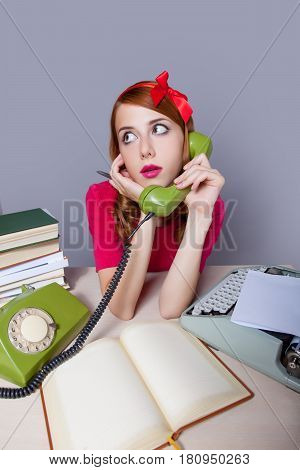 Photo Of Beautiful Young Secretary Talking On The Phone On The Wonderful Grey Background