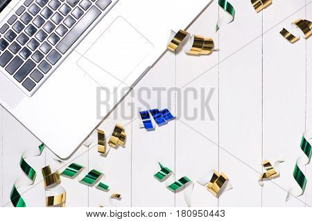 Celebration Flat Lay With Colorful Party Items And Laptop On Wooden Background.