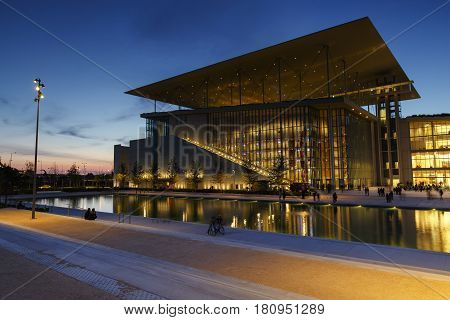 ATHENS, GREECE - APRIL 09, 2017: National Library of Greece and the Greek National Opera in Athens, Greece in the evening of April 09, 2017.