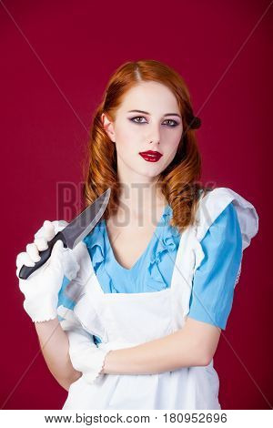 Photo Of Beautiful Young Woman In Alice Murderer Character On The Wonderful Burgundy Background