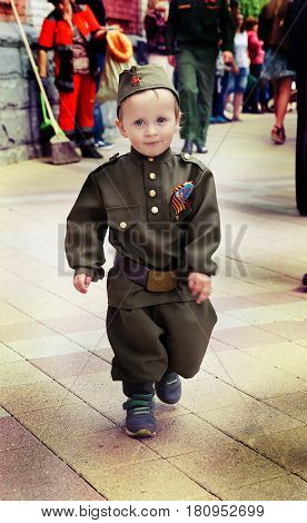 Little boy in military uniform on holiday victory day, May 9, Russia, Krasnodar