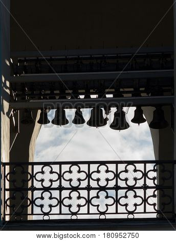Silhouettes of old bronze bells in the bell tower of St. Sophia Cathedral Kiev Ukraine.
