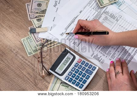 woman filling tax forms. 2017. close up