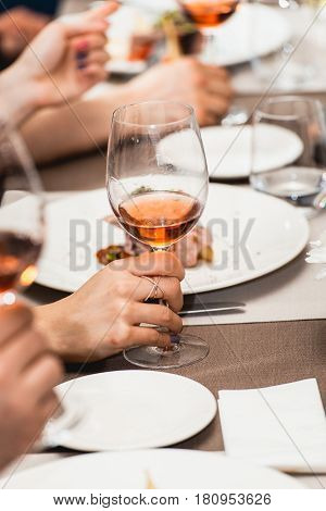 woman drinking wine on a wine tasting in a restaurant.